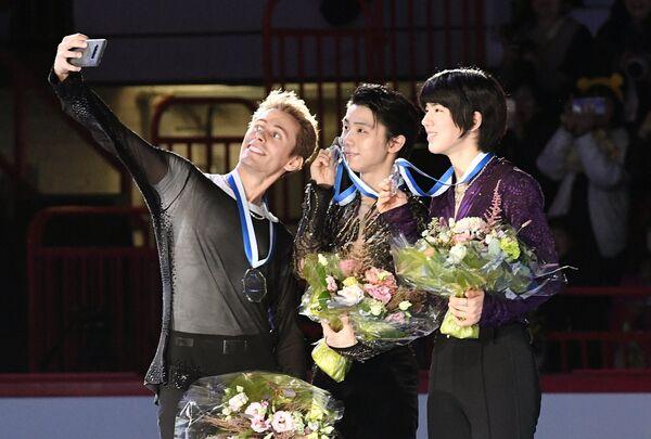 Михал Бржезина, Юдзуру Ханю и Чха Джун (слева направо)