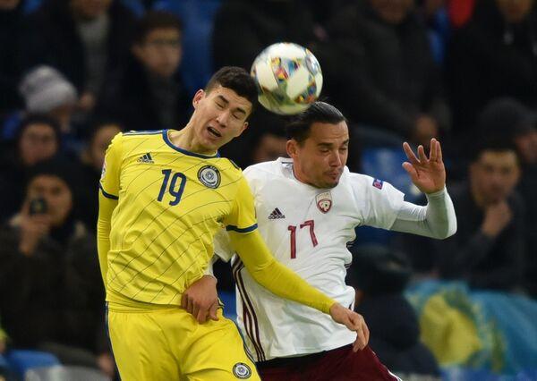 Игровой момент матча Казахстан - Латвия