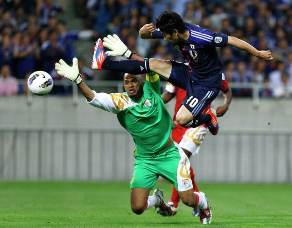 Игровой момент матча Япония - Оман