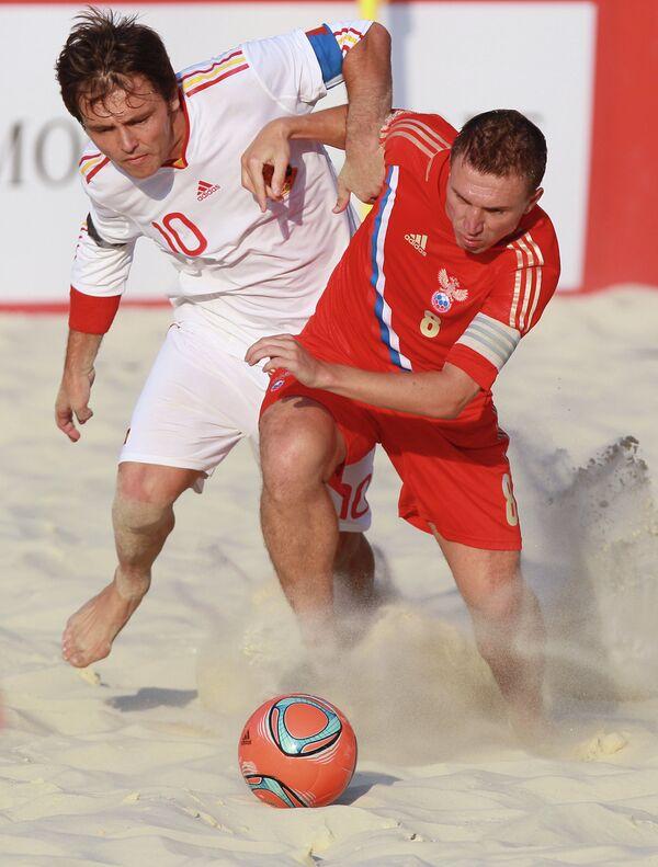 Игровой момент матча между сборными Испании и России
