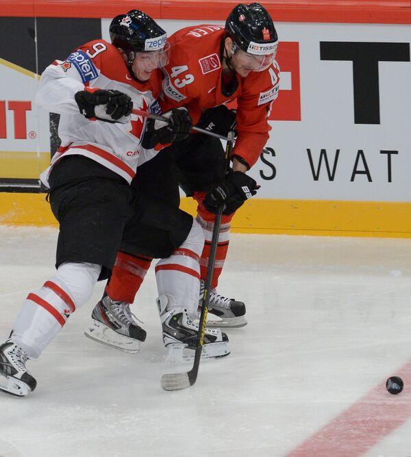 Игровой момент матча Швейцария - Канада