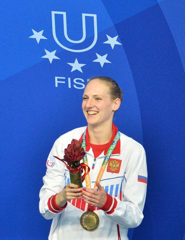 Светлана Ромашина (Россия), завоевавшая золотую медаль в соревнованиях по синхронному плаванию