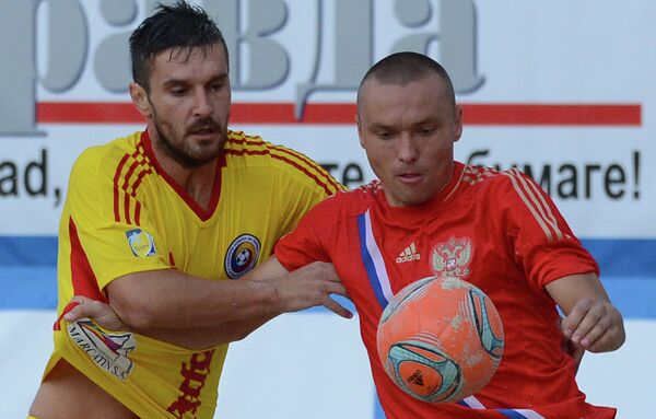 Игровой момент матча между сборными командами России и Румынии