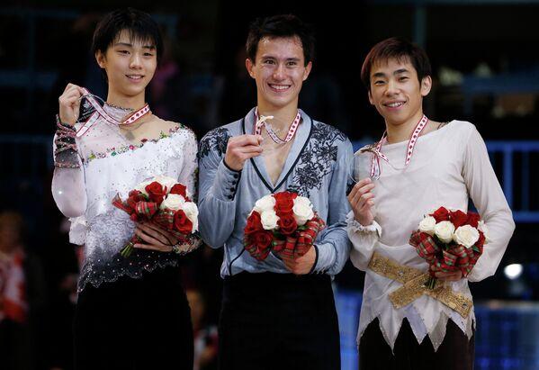 Японский фигурист Юдзуру Ханью, канадец Патрик Чан и японец Нобунари Оду (слева направо)