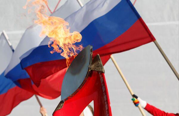 Факел во время Эстафеты олимпийского огня в Петропавловске-Камчатском