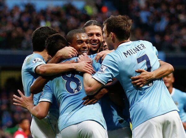 Футболисты Манчестер Сити радуются победе над Арсеналом
