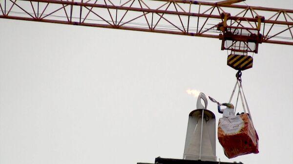 Чашу с огнем ОИ-2014 зажгли на крыше стометровой башни в столице Ингушетии