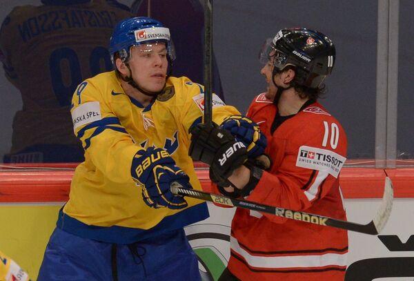 Эрик Густафссон (слева)
