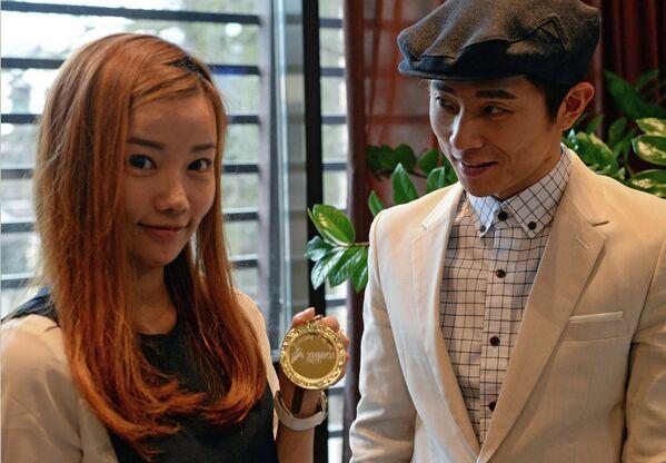 Шестикратный олимпийский чемпион Виктор Ан с супругой Нари