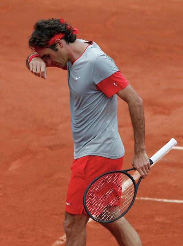 Роджер Федерер в матче против Эрнеста Гулбиса