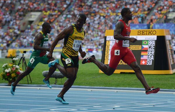 Габриэль Мвумвуре, ямайский спортсмен Неста Картер и американский спортсмен Джастин Гэтлин (слева направо)