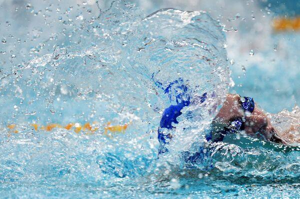 Вероника Попова на дистанции заплыва на 100м