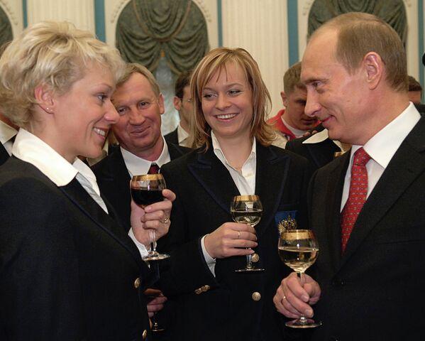 Ольга Зайцева и Владимир Путин (на первом плане)