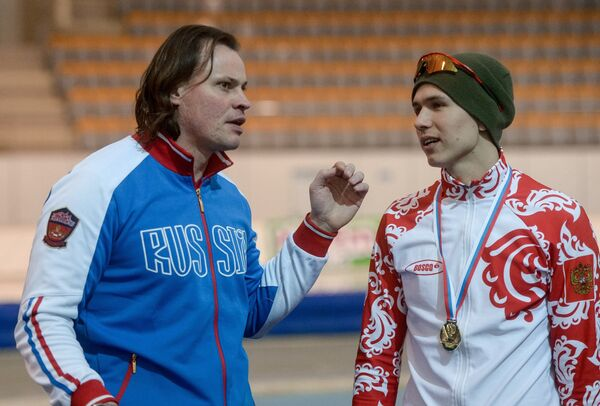 Павел Кулижников (справа)  и тренер Дмитрий Дорофеев