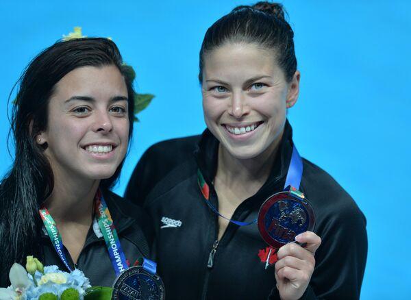 Меган Бенфейто и Розелин Филион (справа)