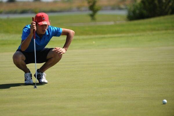 Участник соревнований по гольфу