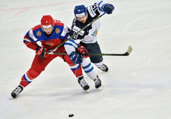 Игровой момент матча Россия - Финляндия