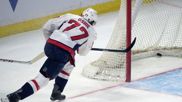 Нападающий клуба НХЛ Вашингтон Кэпиталз Ти Джей Оши