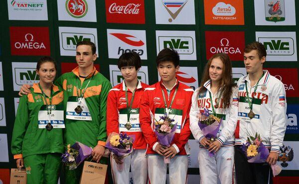 Доминик Бедгуд и Мелисса Ву, Тай Сяоху и Чан Яни, Никита Шлейхер и Юлия Тимошинина (слева направо)